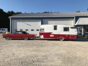 Red & White Aluminum Camper.